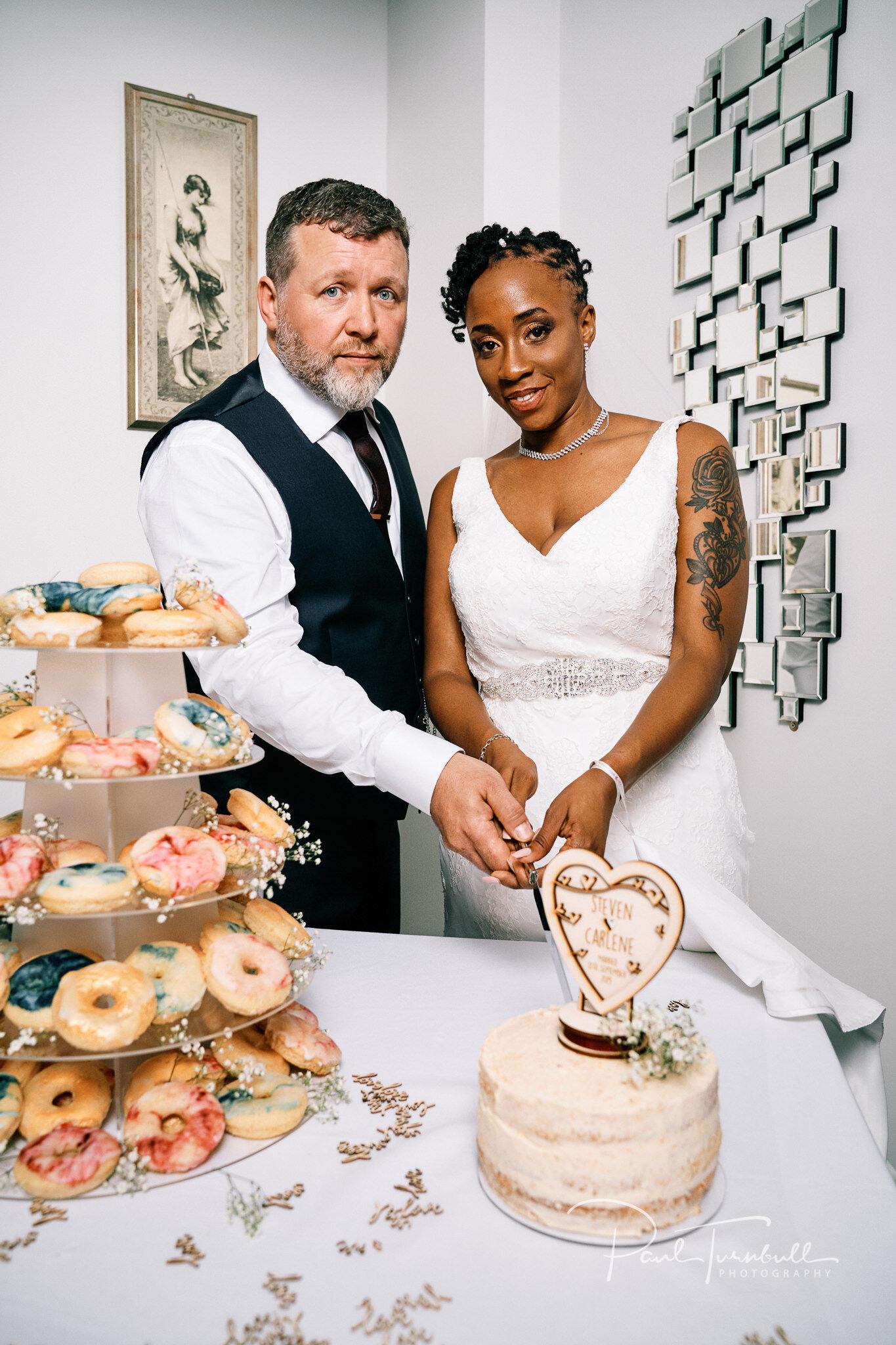 Cutting the wedding cake at Lazaat Hotel. Bride and groom enjoying the gardens of Lazaat Hotel. Wedding photographer Hull