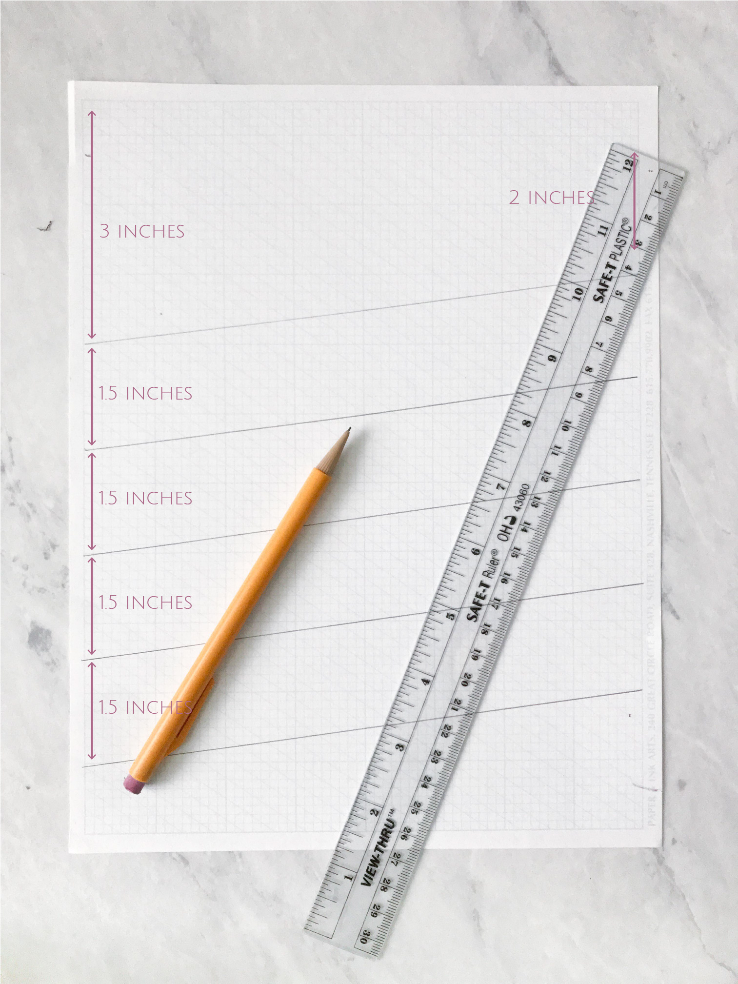 """STEP 1:making a diagonal template - You can make all kinds of layouts, this one is for writing five lines on a diagonal. On the left margin of your grid paper, measure 3"""" from the top, make a little notch mark. On the right margin of your grid paper, put a notch at 2"""" from the top. Use your ruler to create a straight line between the two notches. You have your first diagonal line!For the next four lines, measure 1.5 inches below the previous notch on both the right and left side of the page."""