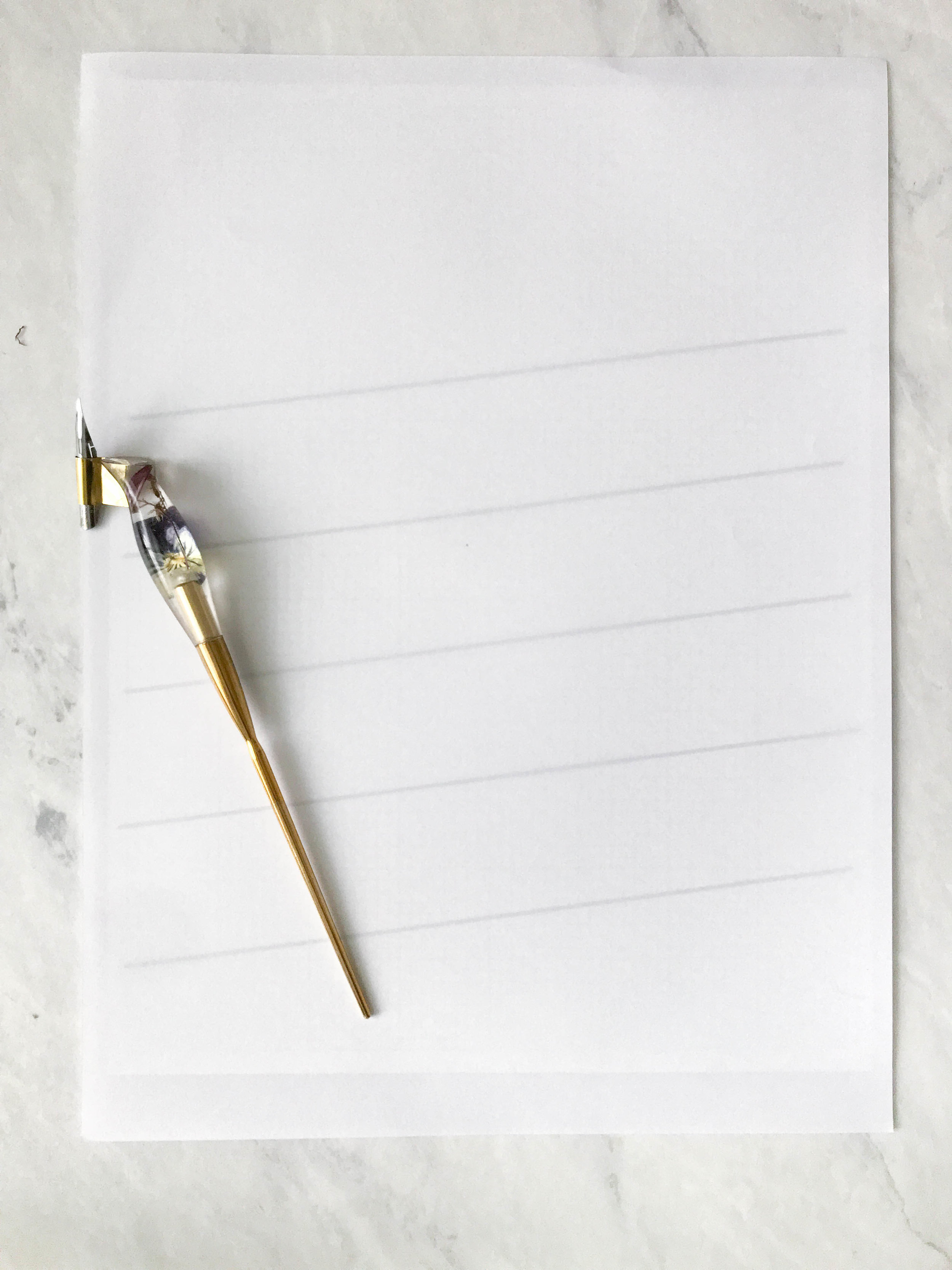 STEP 3:Layer your papers - Place your marker paper on top of your template. You can also clip this on your clipboard to prevent the paper from moving!If you want to practice first, you can write your letters in pencil and then get the dip pen out to trace over your pencil lines.