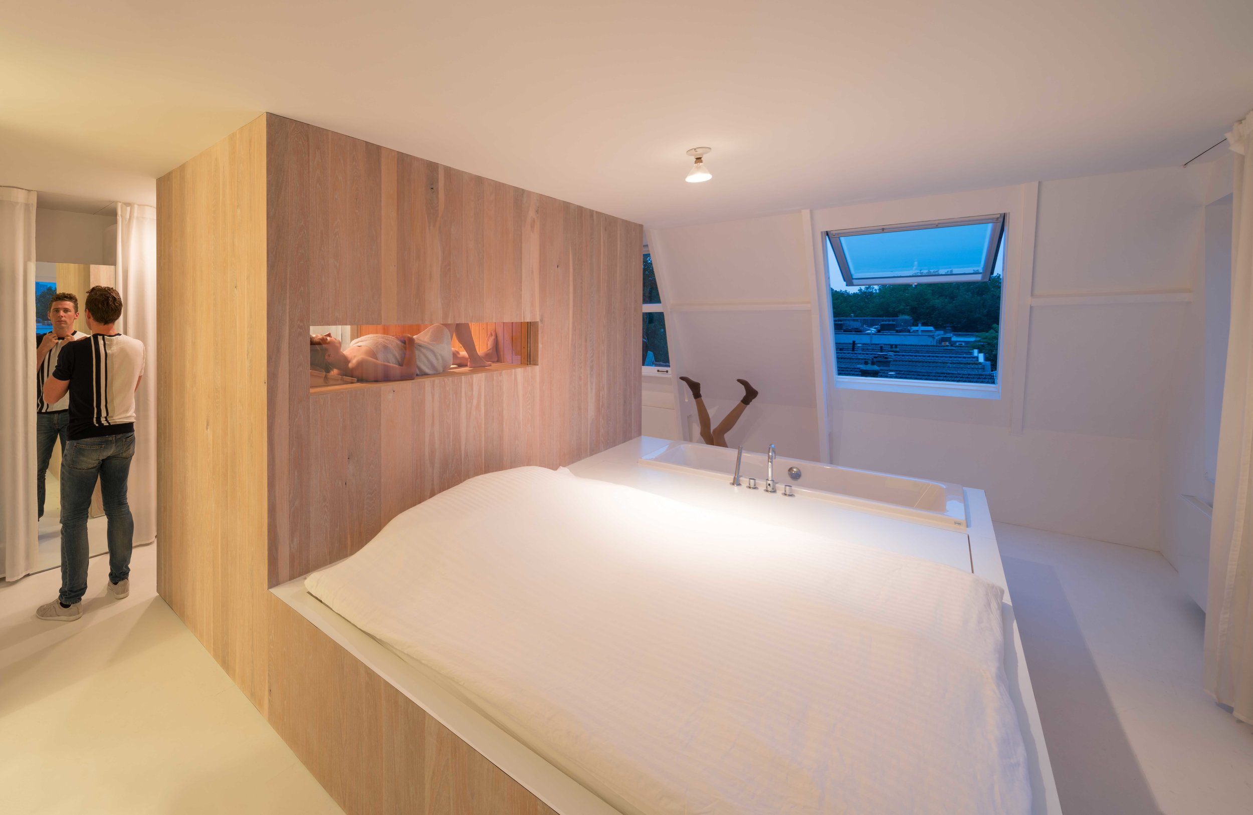 the wooden element containing the welness functions: bath tub, sauna and steam shower