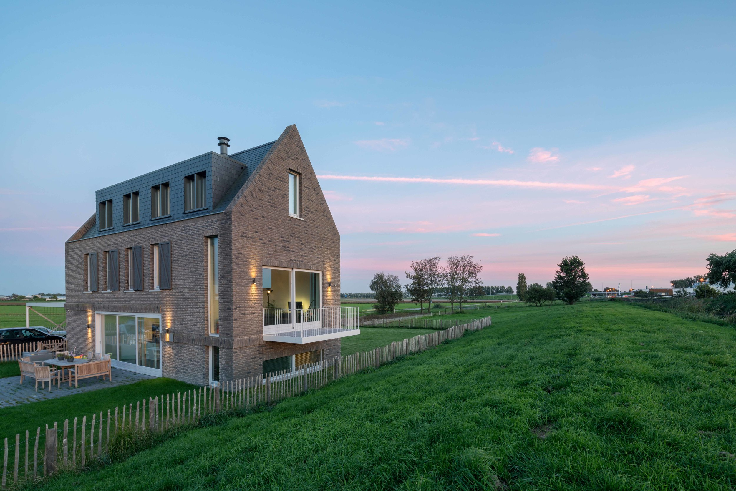 """""""not a box in an empty field""""   contemporary variation on the classic Dutch dike house"""