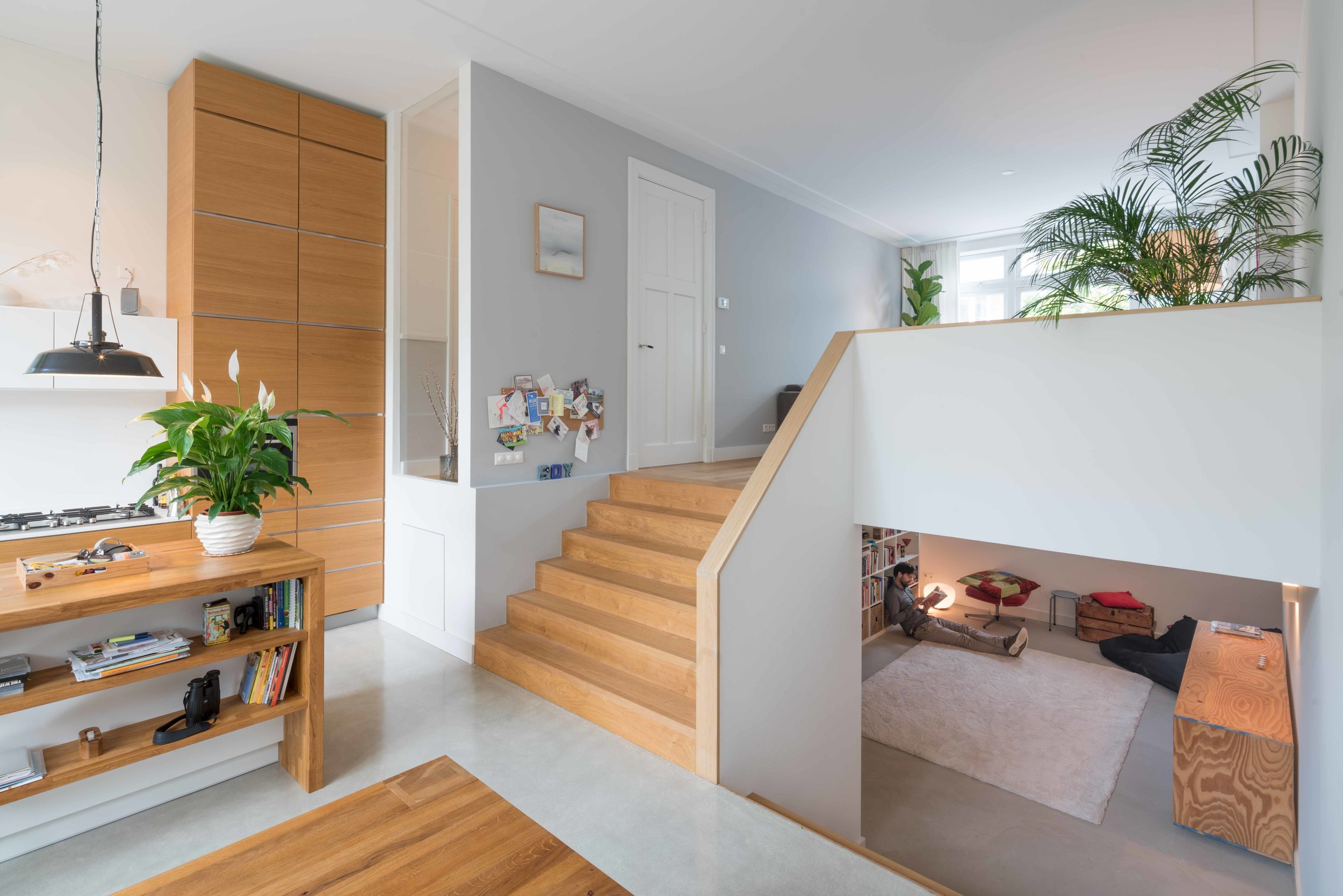 split level with wide stairs connecting living, kitchen and dining area with the basement