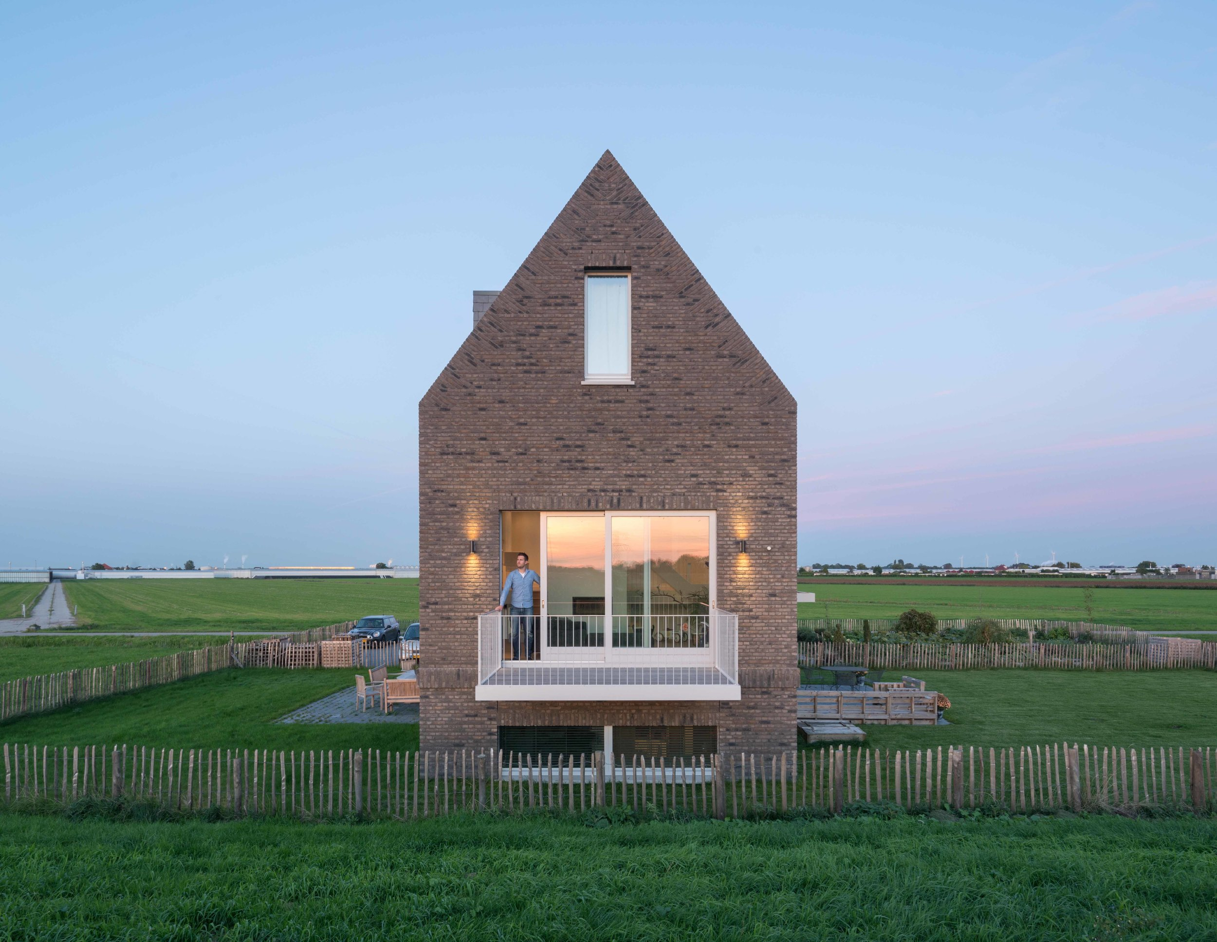 at first glance it is a traditional dike house, a second look will reveal its contemporary and mysterious characteristics