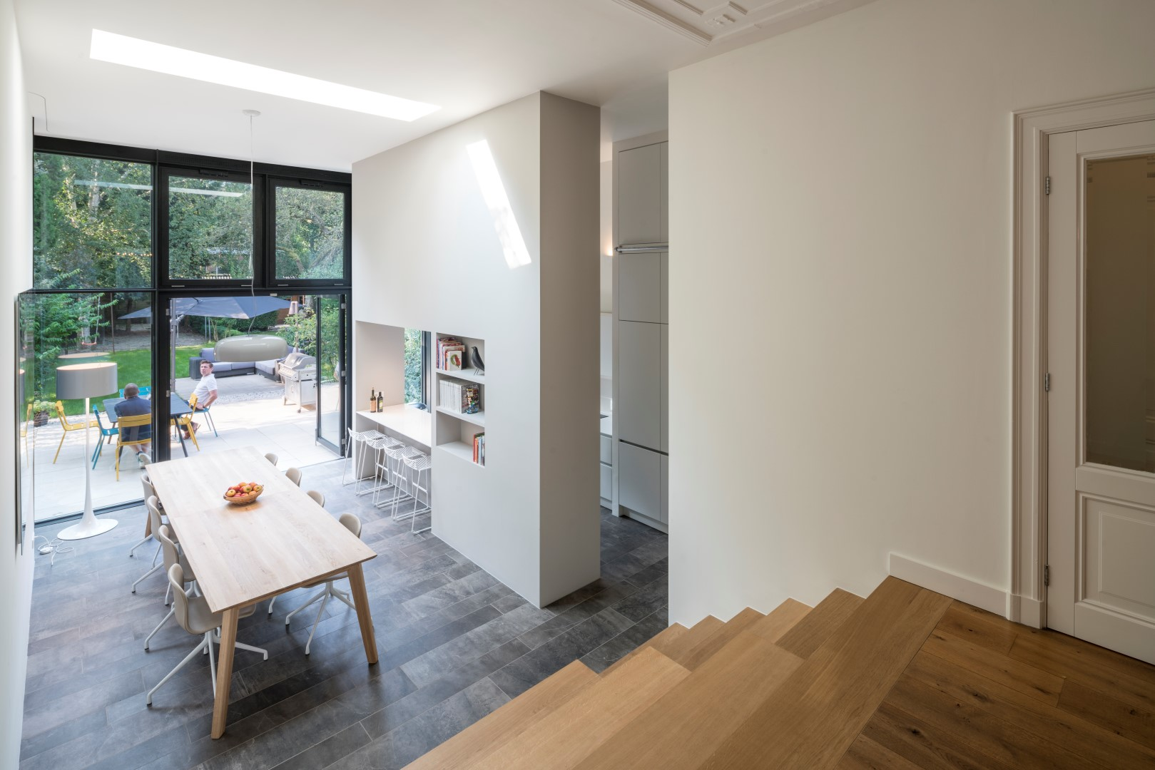 the ground floor extension with the wide tribune creating a gentle flow between the living room and garden level