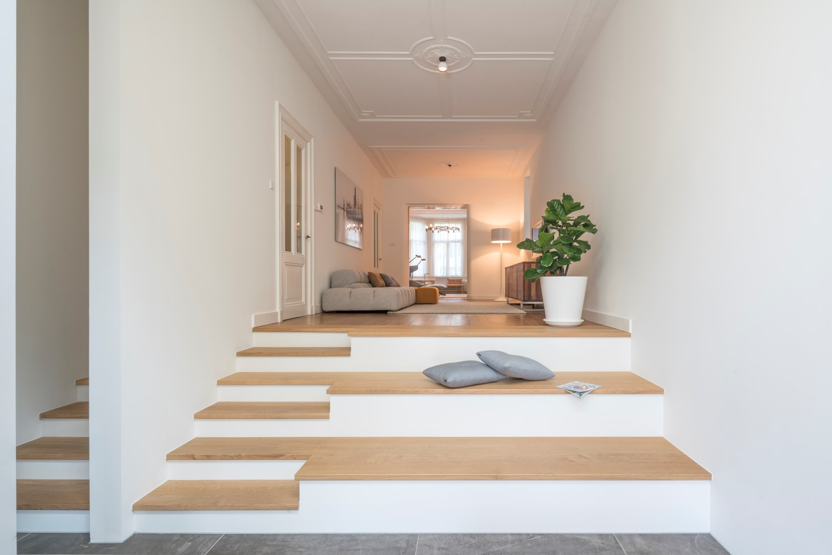 the stairs do not only connect the levels but also provide space to sit down and relax