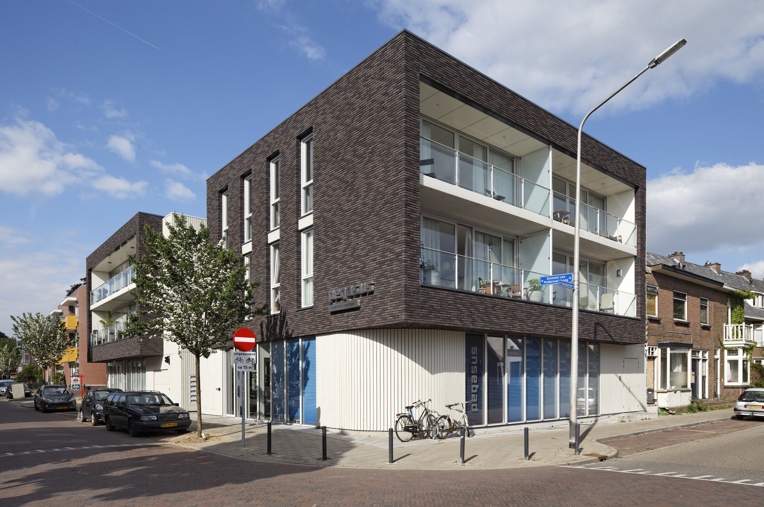 the corner of the ground floor is rounded off allowing a gentle flow from one street to the other