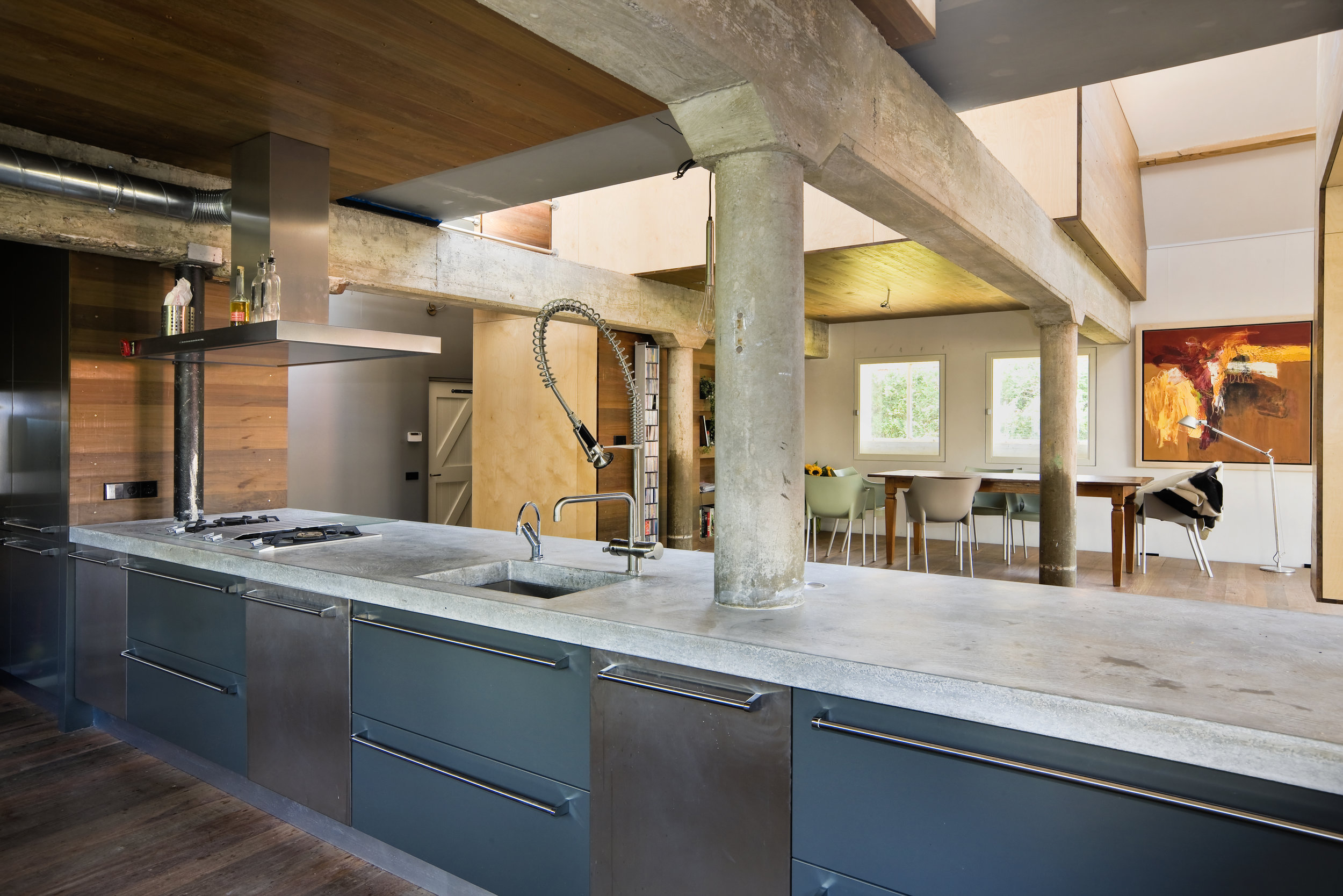 the floor of the kitchen is slightly elevated, offering a good view on the surroundings through the former stable windows