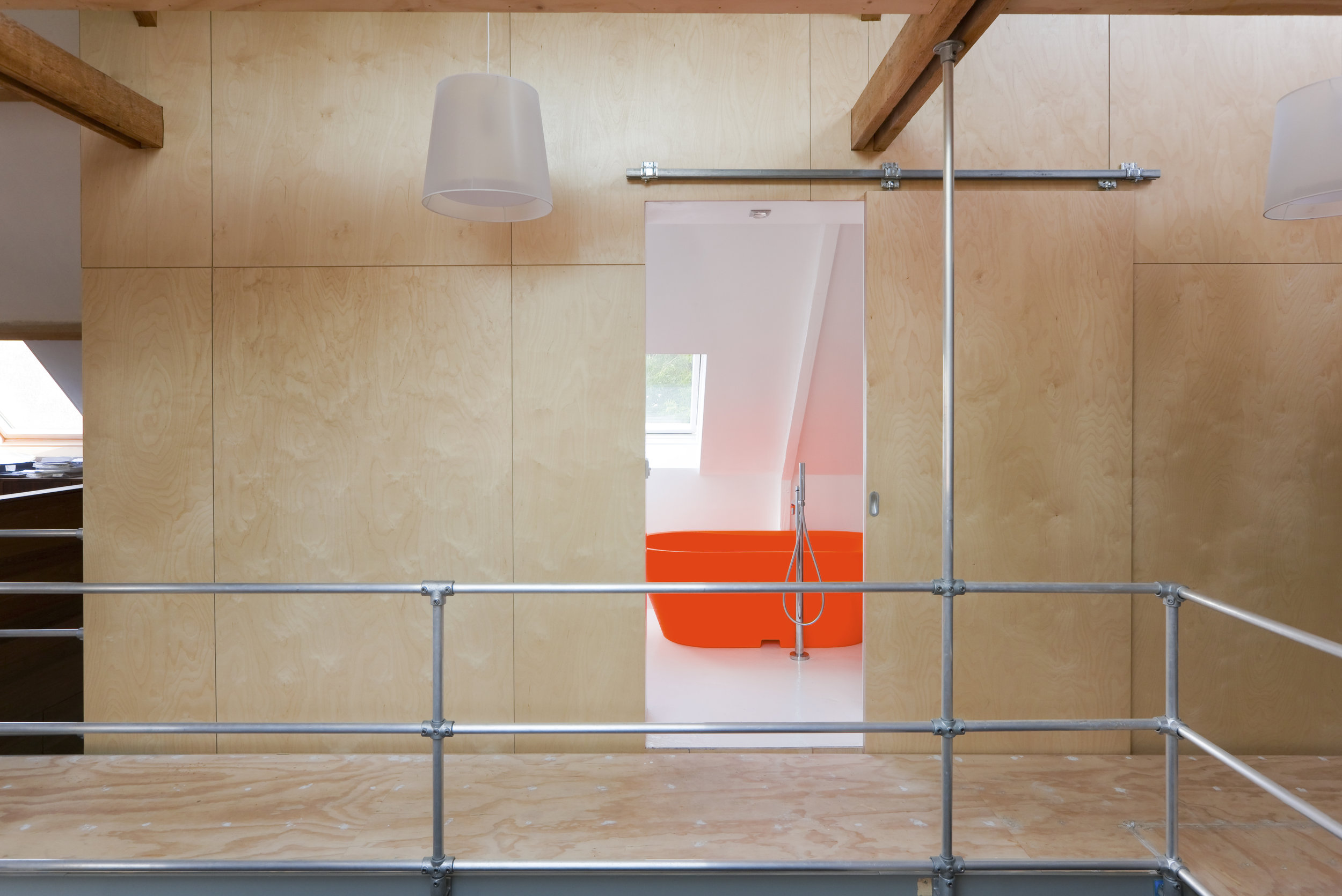 the element is clad with birch fineer, the bathroom inside is kept completely white (except for the bathtub ofcourse)