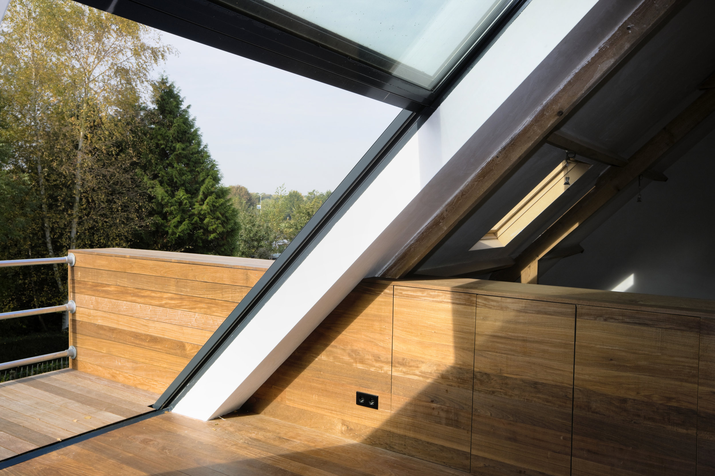 a large upward sliding window gives access to the balcony and allows for light to enter the former stable