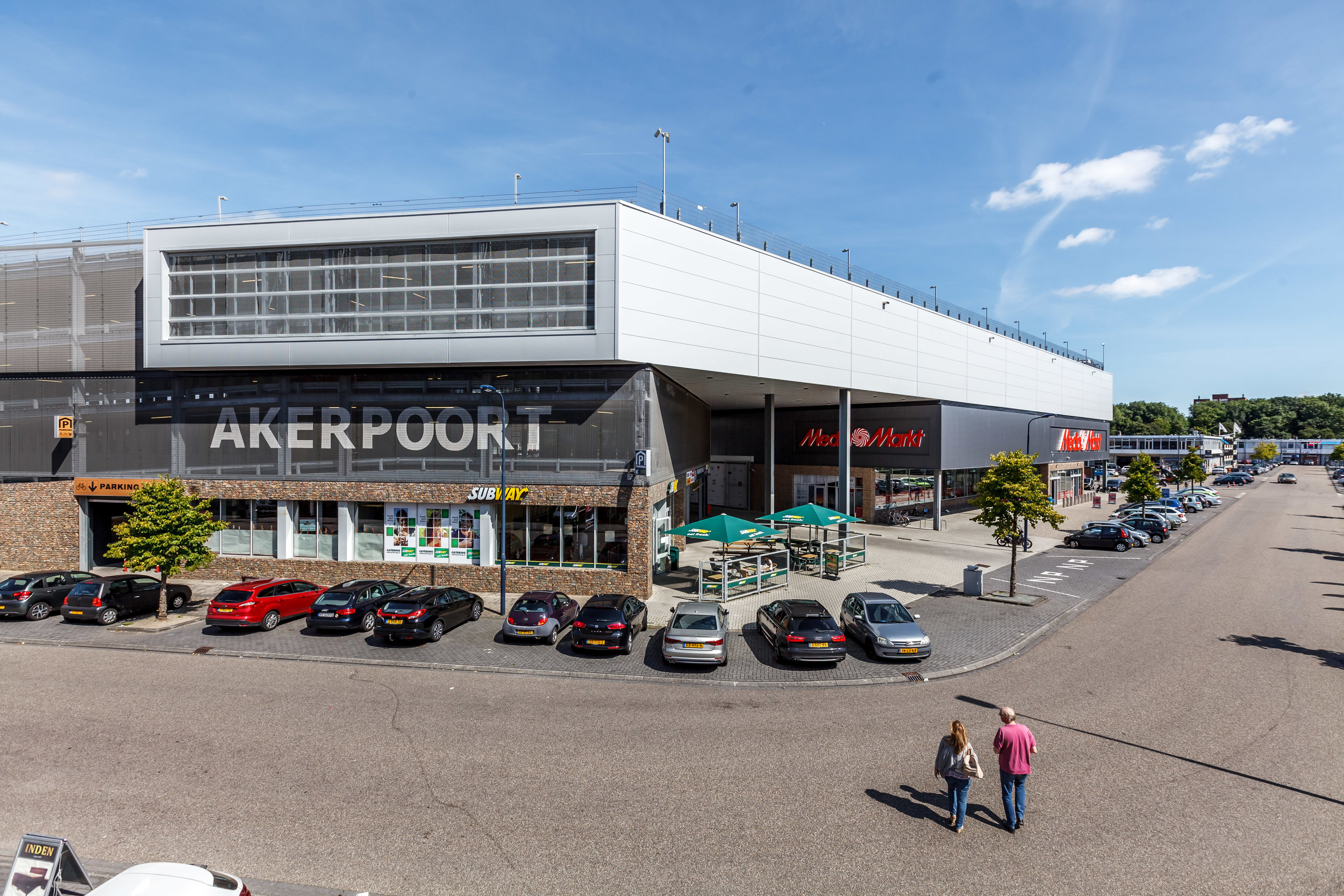 corner of the complex marking the entrance to the parking and shopping area covered with a large roof