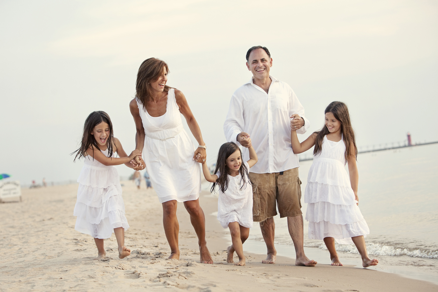 family portrait on beach wearing white