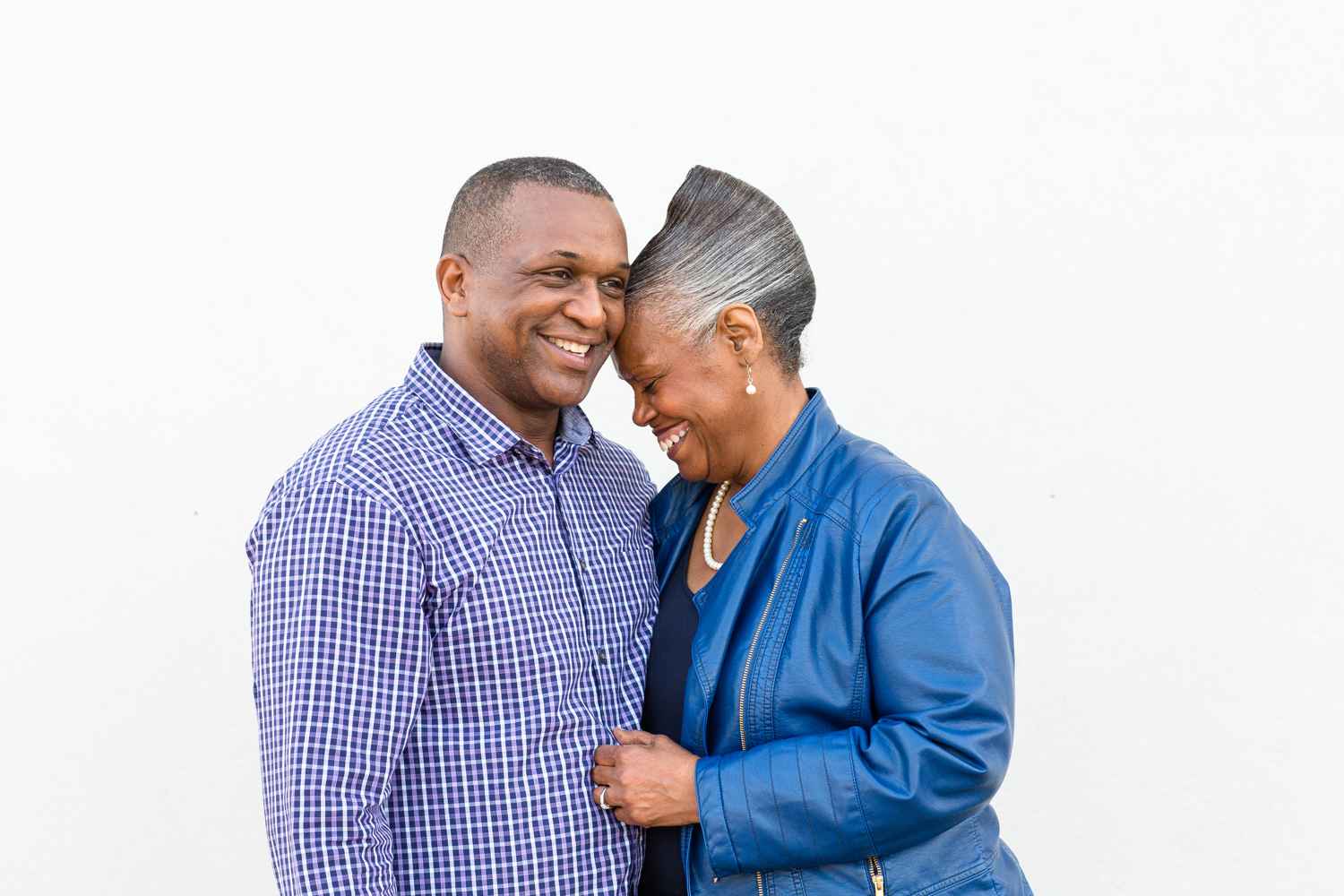 couple in front of white wall