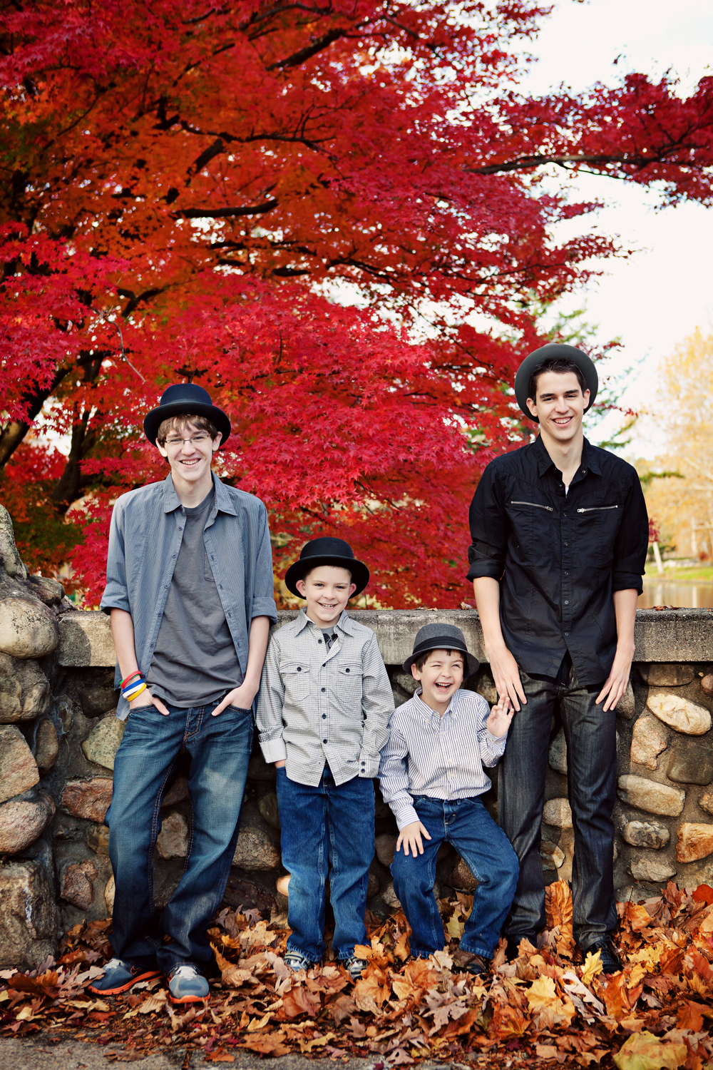family portrait brothers in front of red japanese maple tree