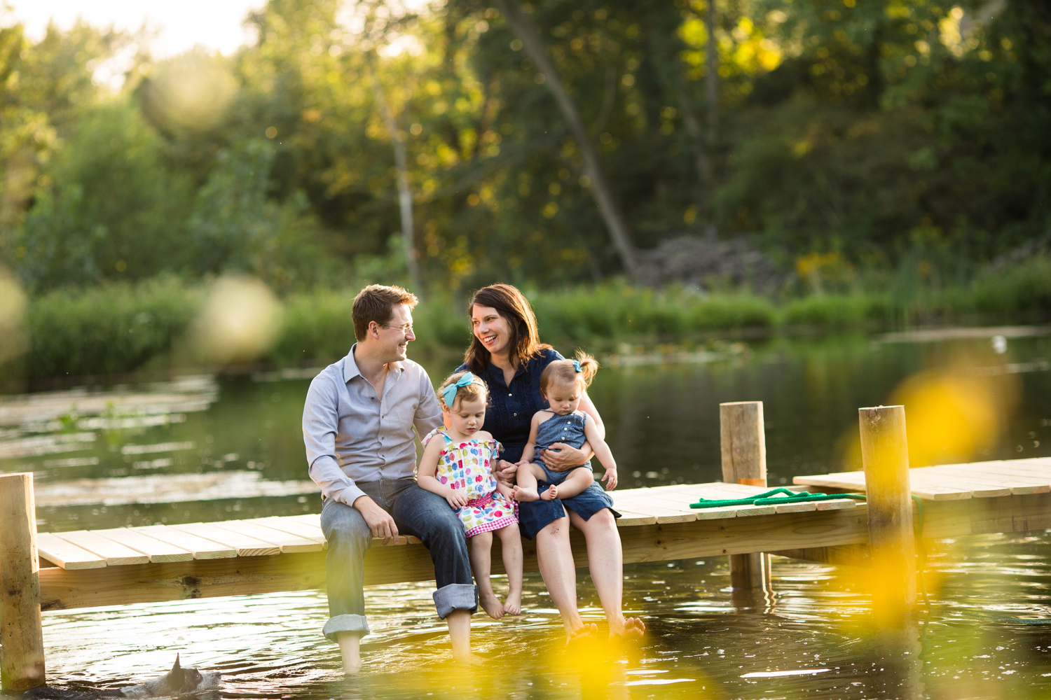 family on dock with lake