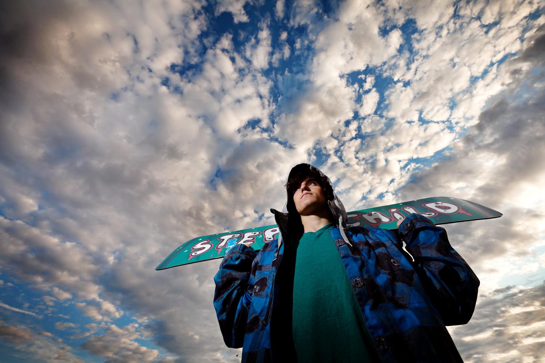 senior portrait snowboard sky