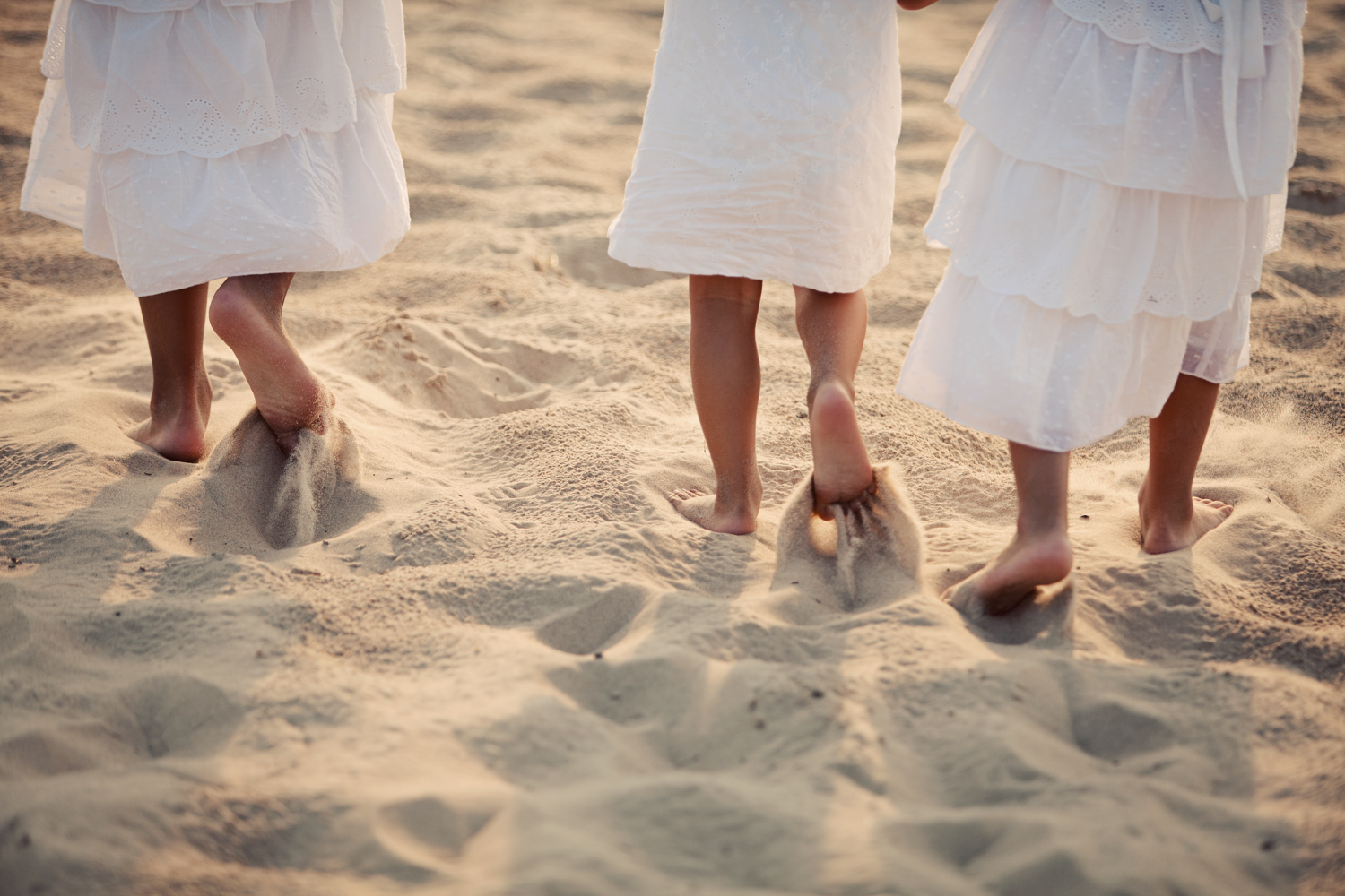 sisters feet in sand