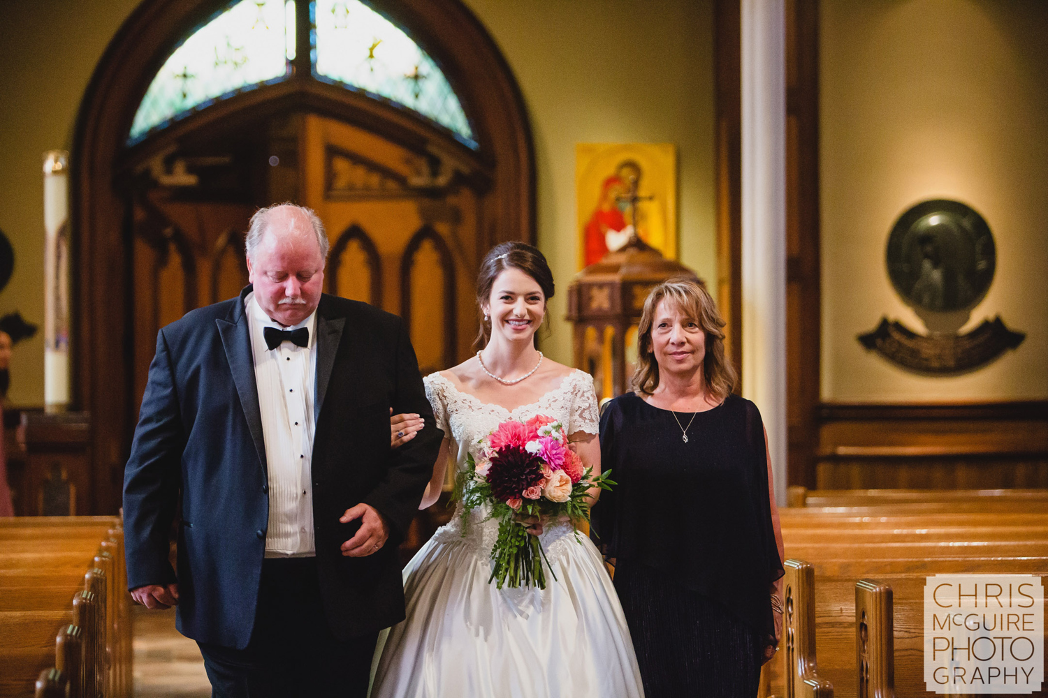 bride with parents in aisle