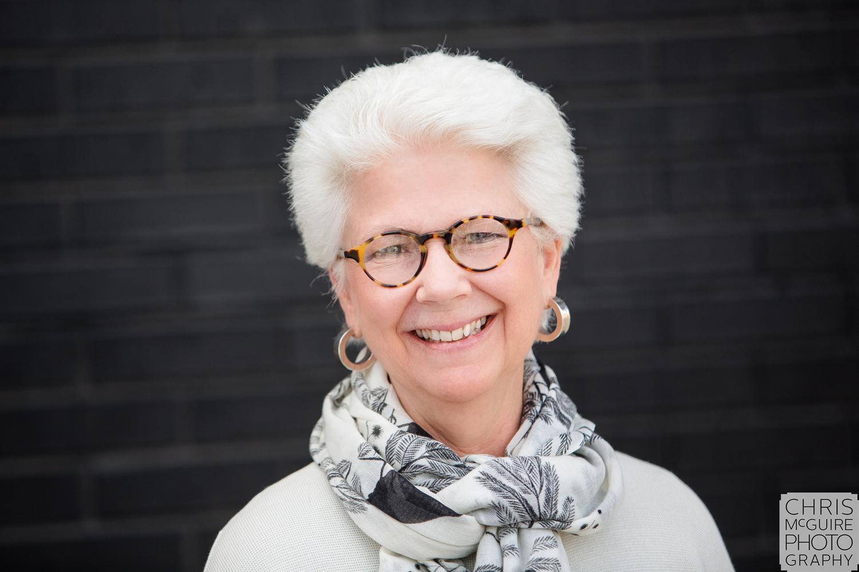 woman business portrait with black brick