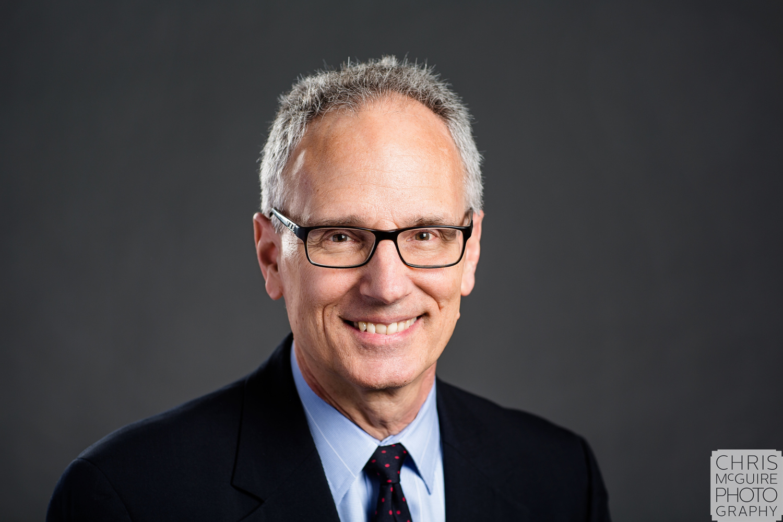 executive headshot grey background