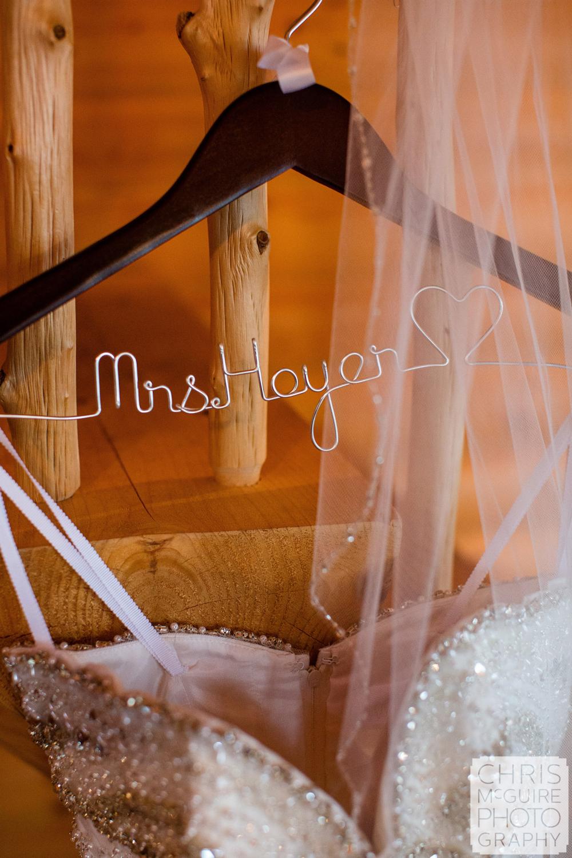 wedding dress on hangar with veil