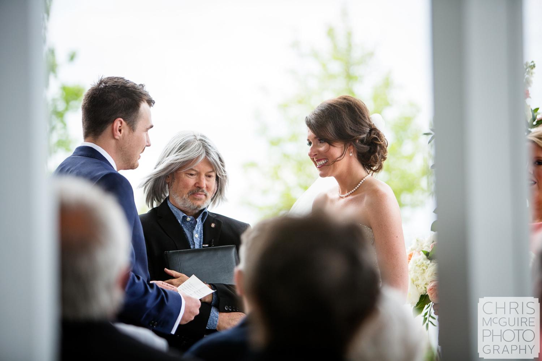 bride smiles at groom during wedding