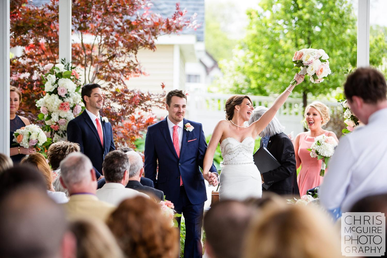 bride cheers after wedding ceremony
