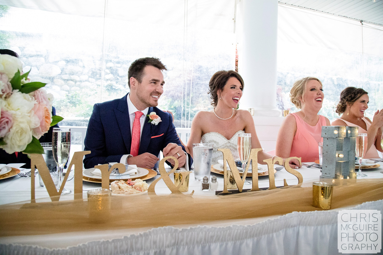 bride groom laughing during wedding toast