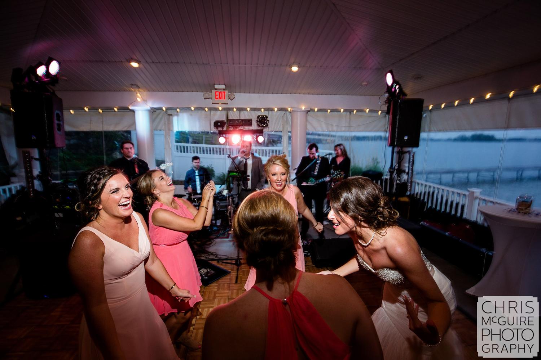 bride dances with bridesmaids