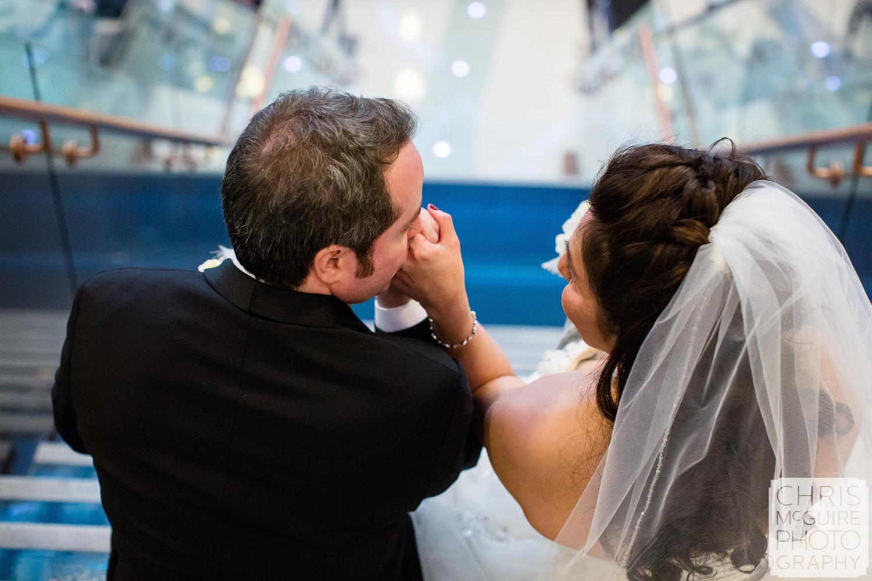 bride groom kissing hand