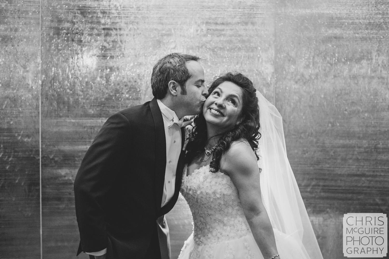 groom kissing bride casino wedding