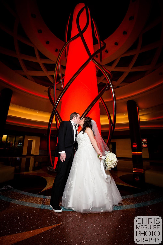 bride groom kiss at firekeepers casino wedding