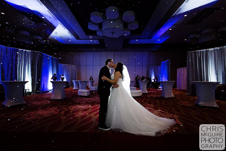 bride groom kiss ballroom snow machine