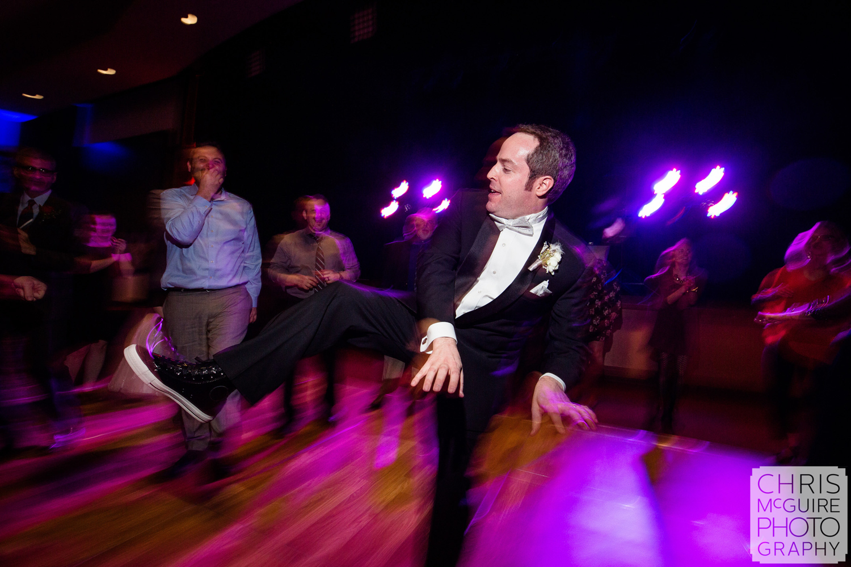 groom playing air piano on dance floor peoria wedding