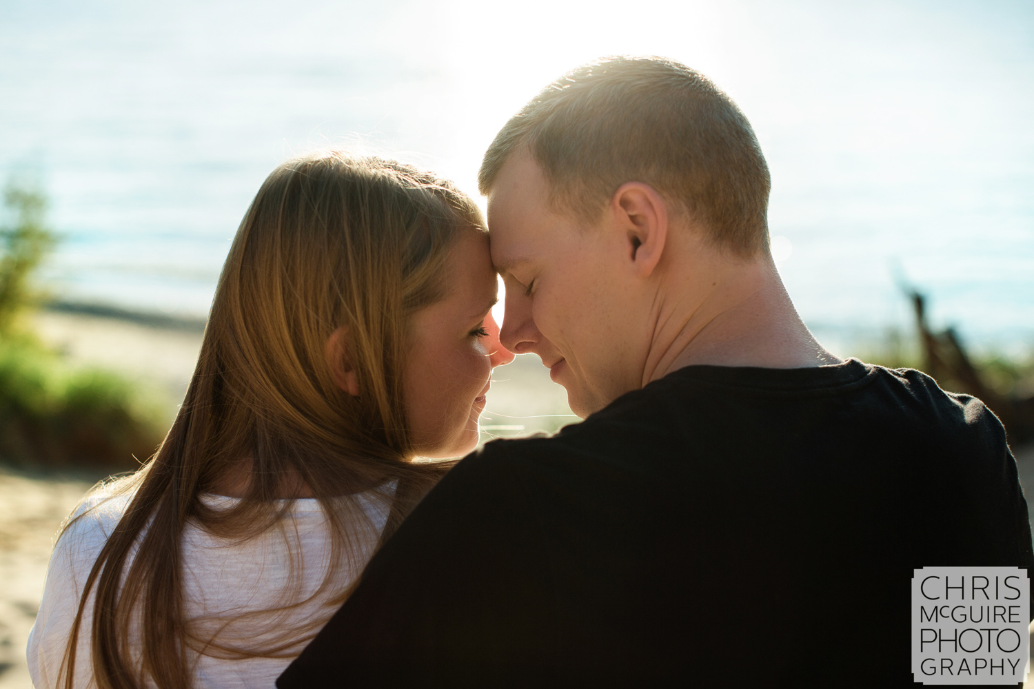 couple foreheads at beach