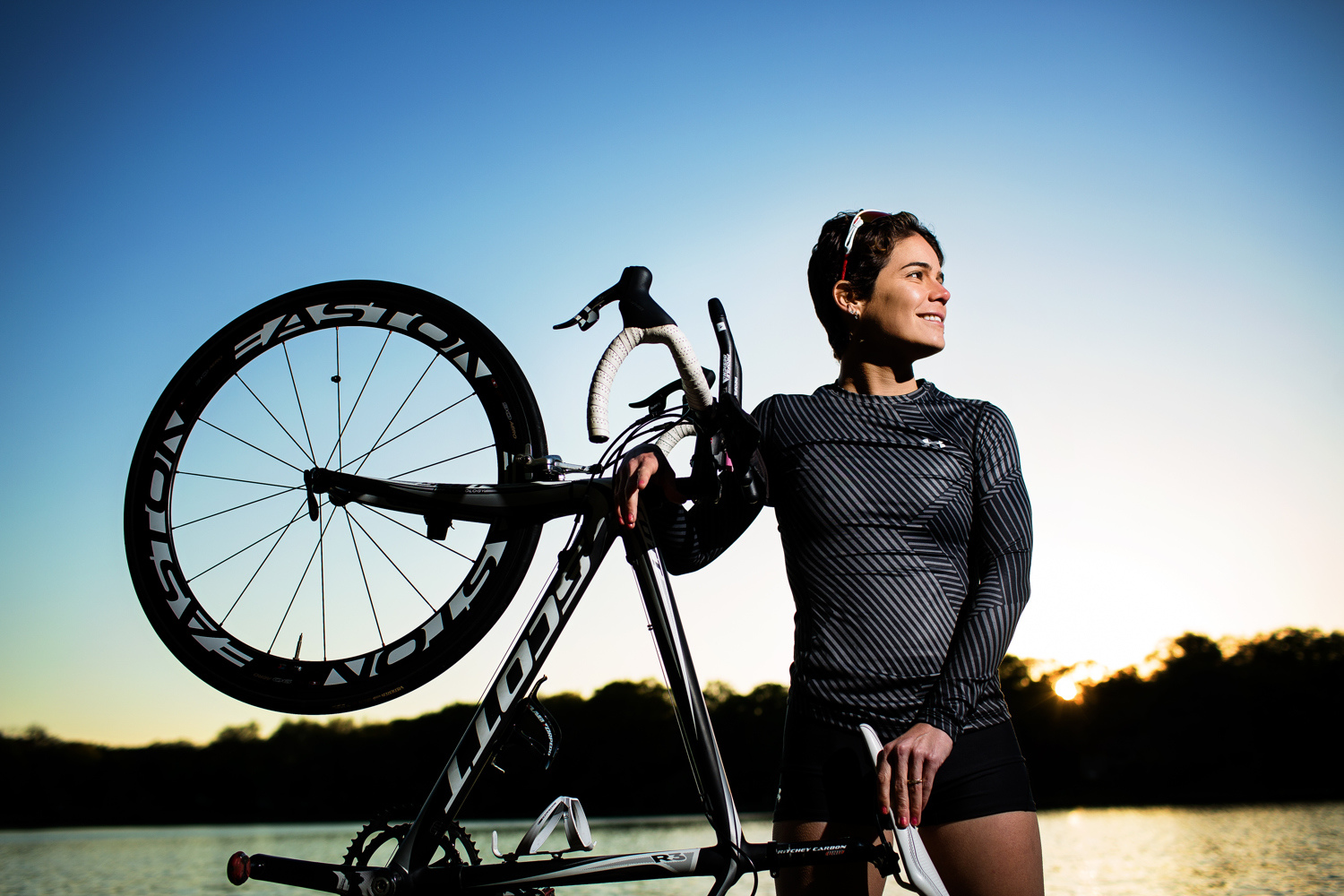 athlete with bike by lake