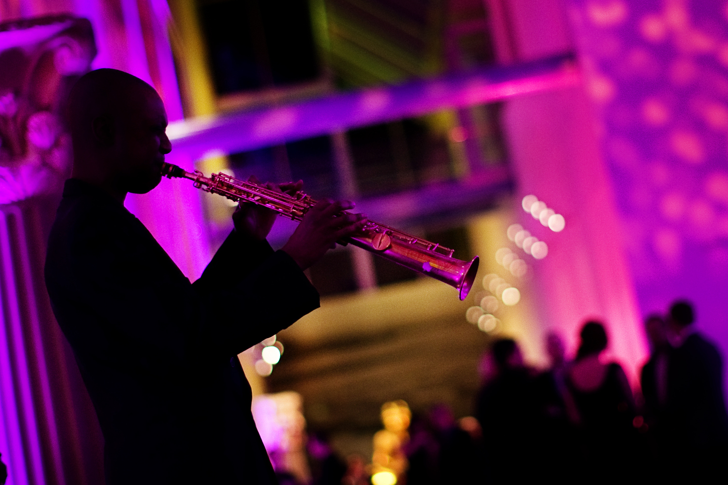 saxophone plays at event