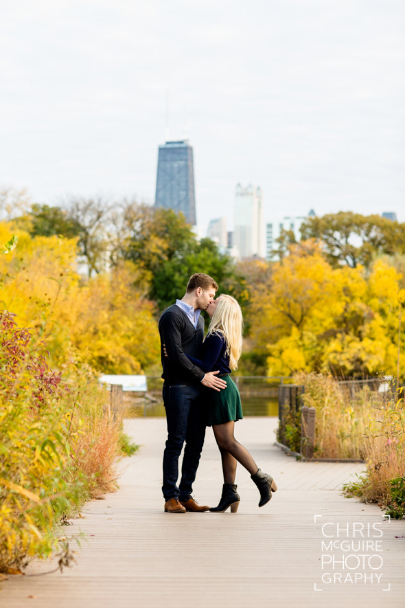 couple kissing with fall colors and hancock building