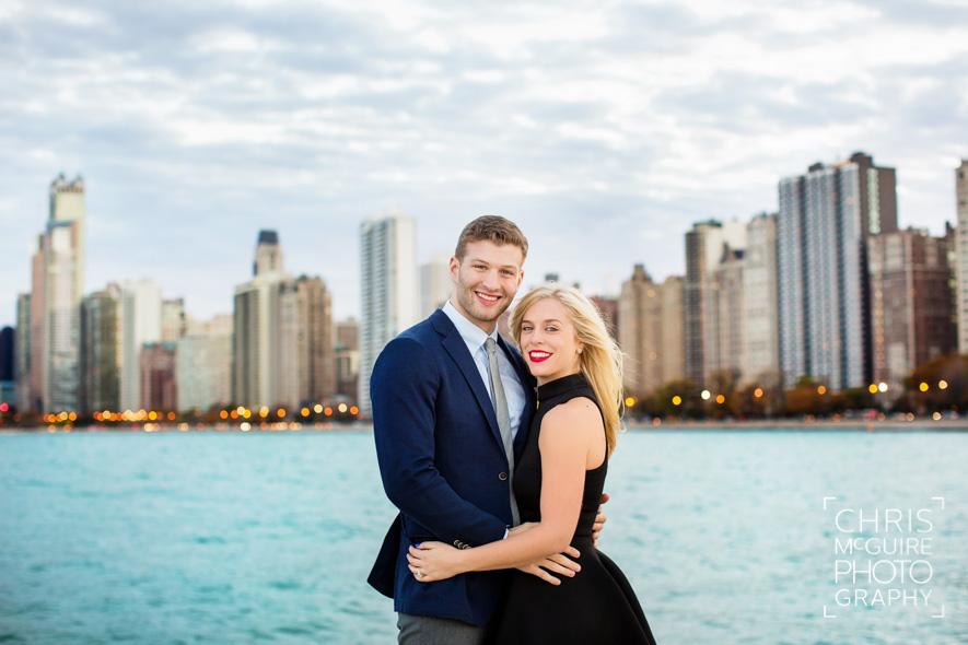 engaged couple with chicago skyline lake michigan