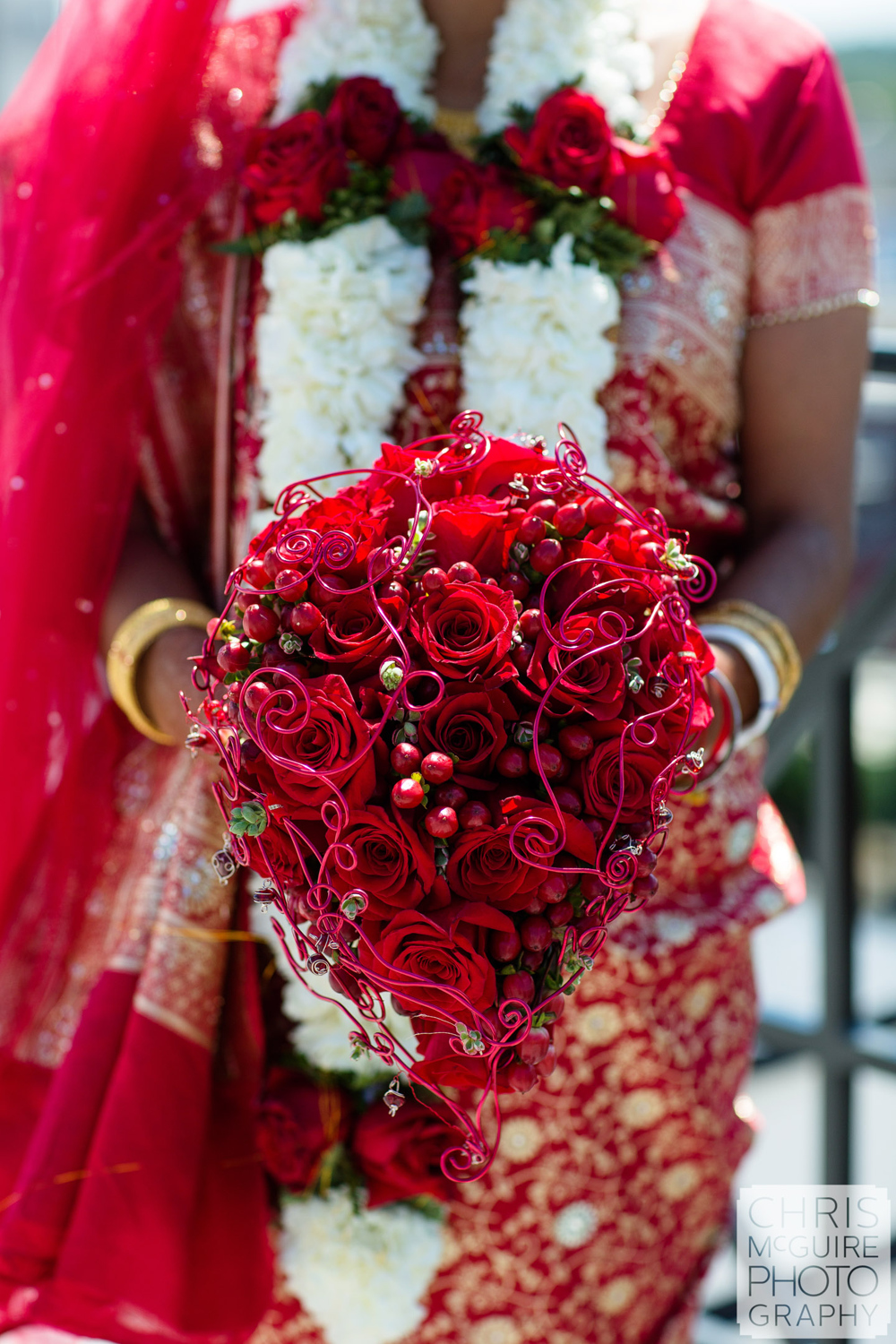 indian bride with rose bouquet