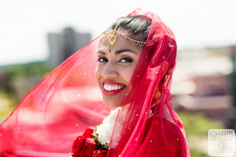 indian bride smiling red veil