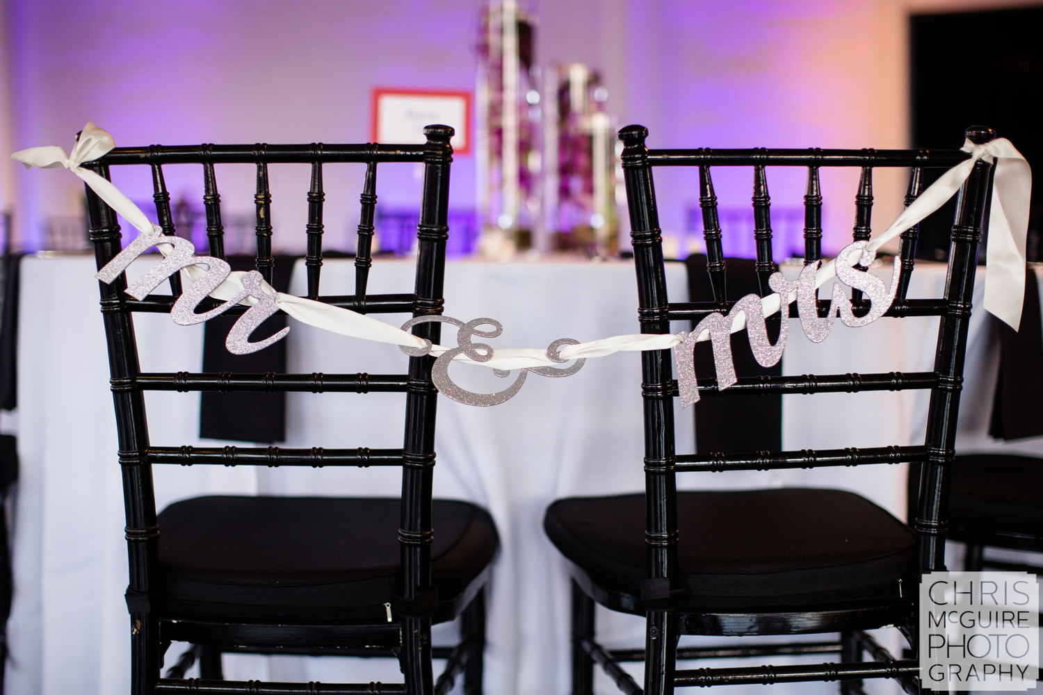 mr and mrs signs on chairs at wedding reception