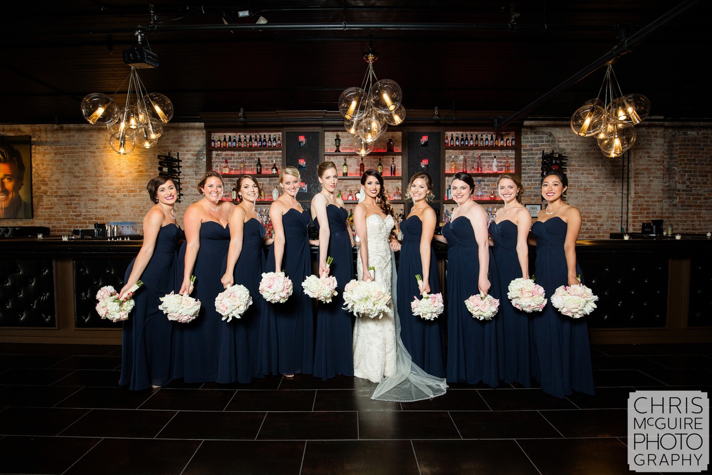 bride and bridesmaids posing in bar