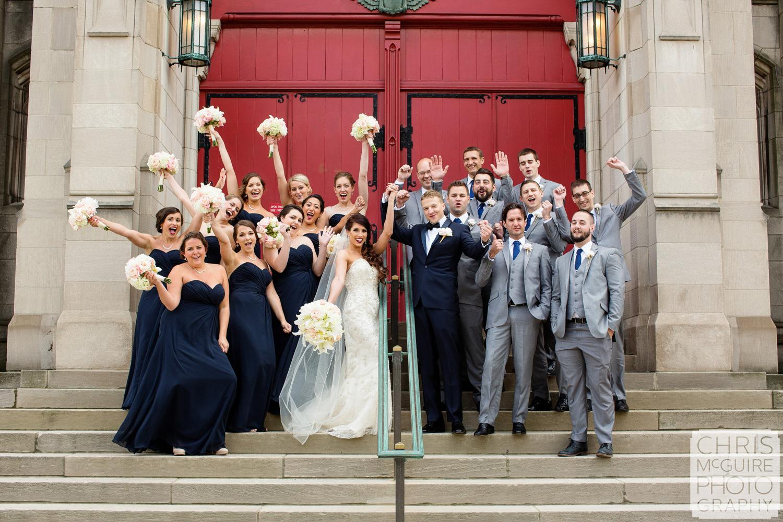 wedding party on steps in front of red door