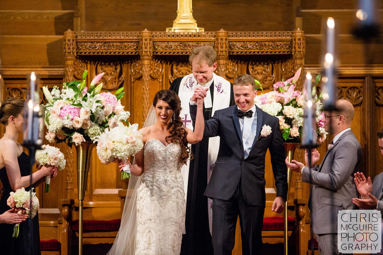 bride groom cheer at wedding