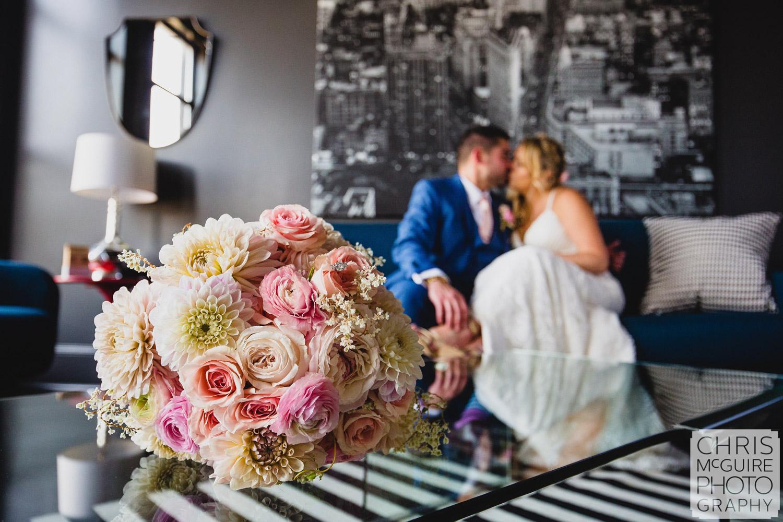 bride groom kissing behind bouquet