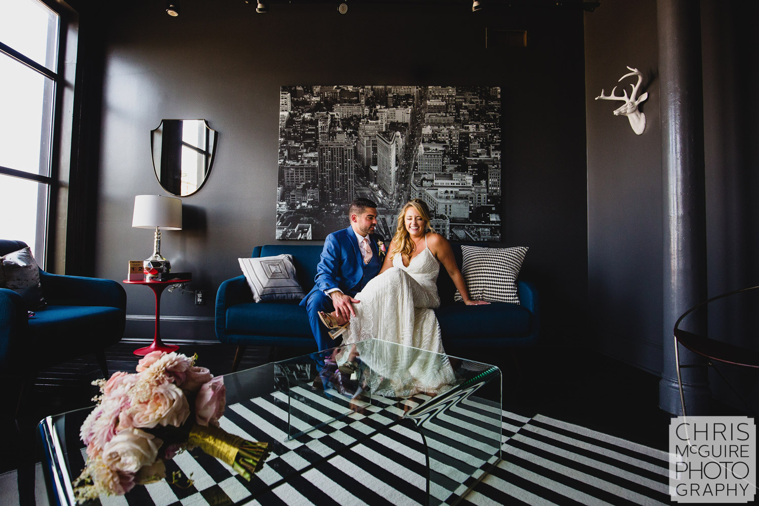 bride laughing with groom inside portrait