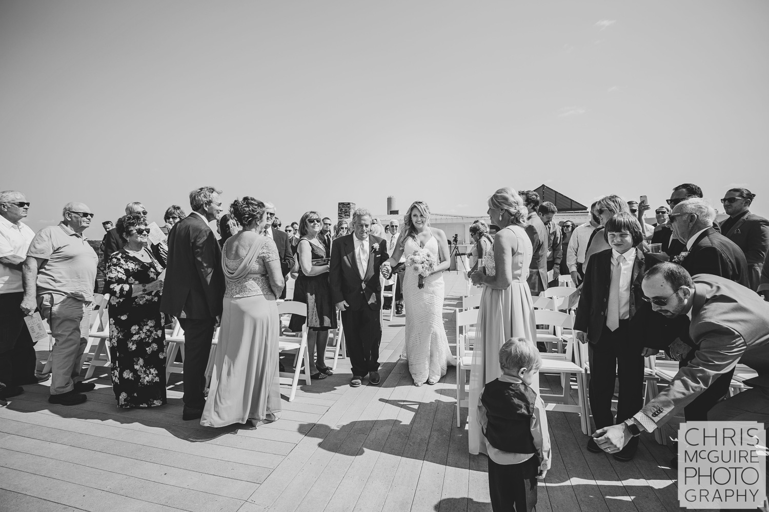 bride and father walking down aisle at rooftop wedding