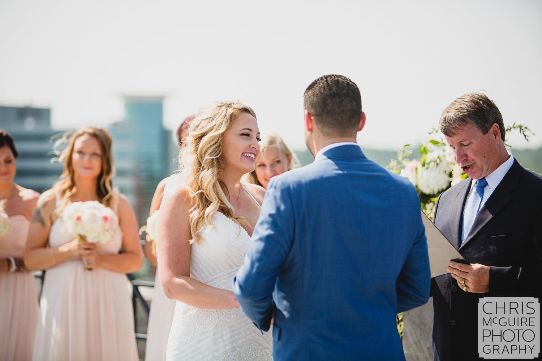 bride laughing during wedding vows