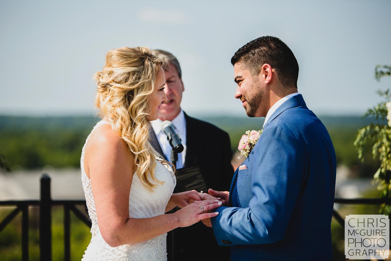 bride groom exchanging wedding rings