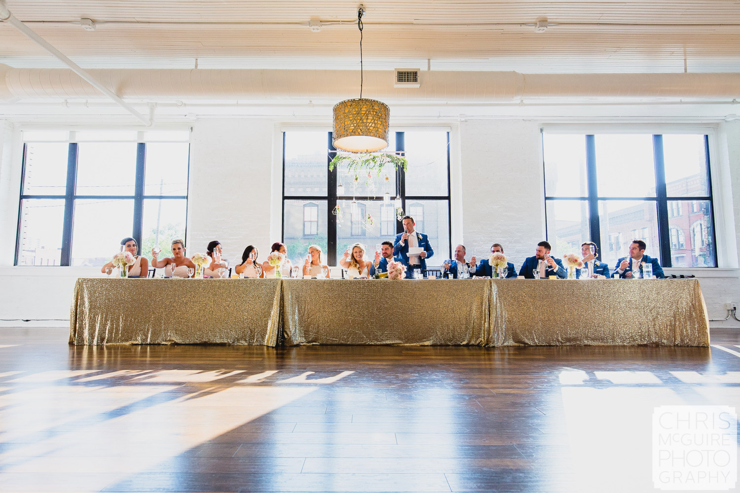 wedding party with gold tablecloth windows